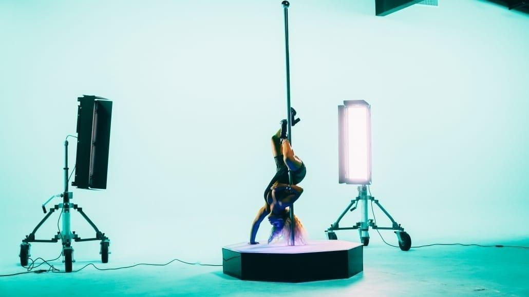 Pole Dancer on Set on All Star Stages Portable Dance Pole Upside