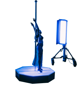 Blue Version Praising the Pole Dance Gods on an All Star Stages Commercial Grade Portable Dance Pole on Set During Production-