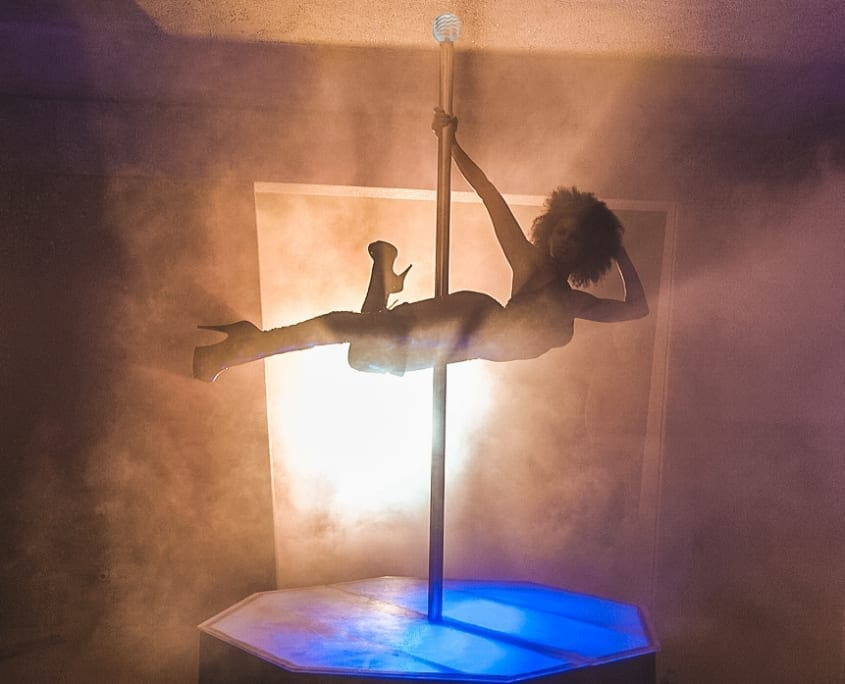 Pole Dancer on Dark Knight on Music Video Set Poses with All Sta