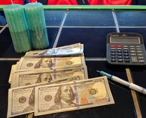 new hundreds style prop movie money on a counter with calculator and pen (1)